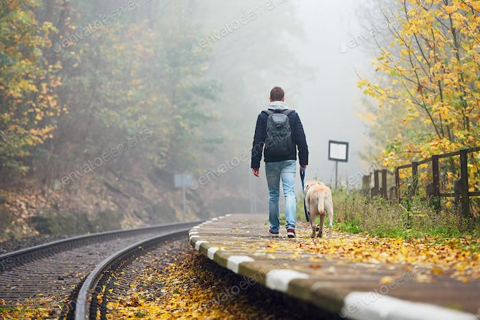 Man traveling with his dog by train