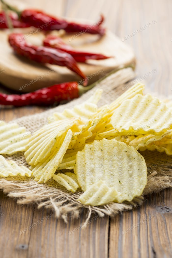 Eco potato chips on a wooden background.Studio photo.