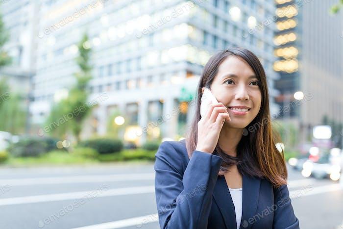 Businesswoman talk to cellphone in Tokyo city