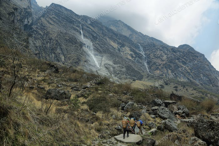 Amazing waterfall falling from the rocky peaks n