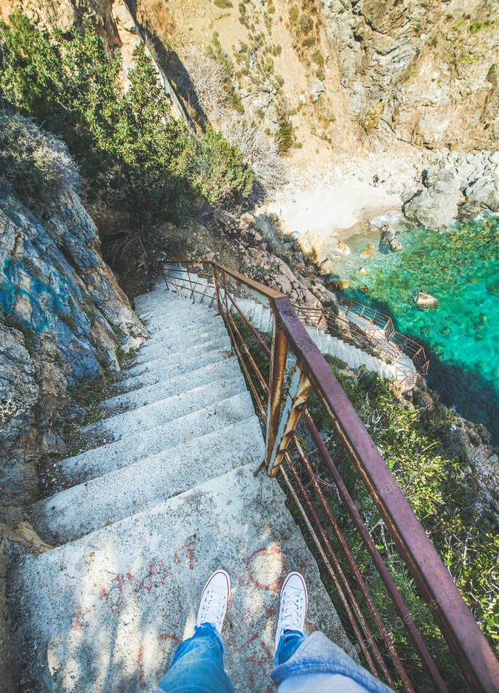 Stairs down to secret lagoon at Mediterranean sea coast