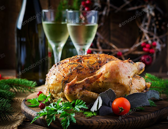 Baked turkey or chicken. The Christmas table is served with a turkey