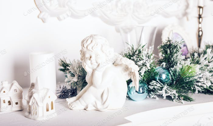 Christmas angel figurine on white table