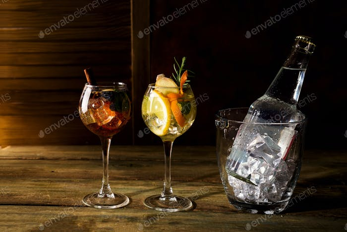 different types whiskey based cocktails with Glass ice bucket on dark wooden backgorund