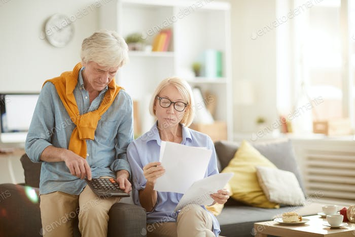 Senior Couple Calculating Taxes