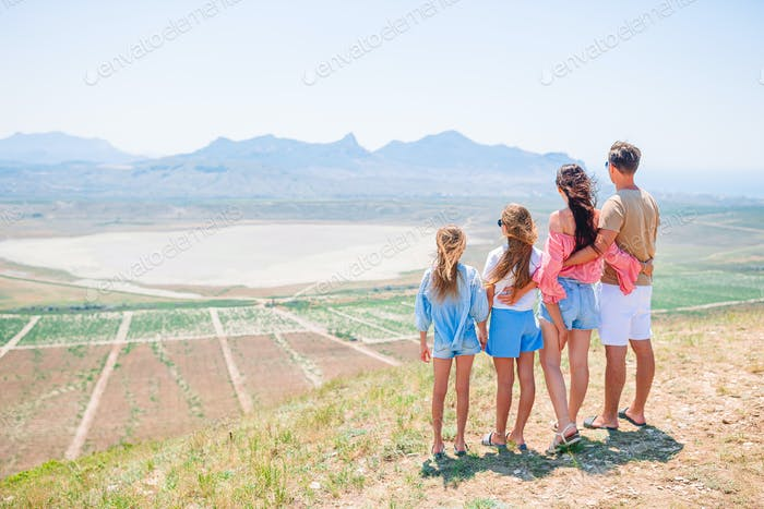 Happy family on vacation in the mountains