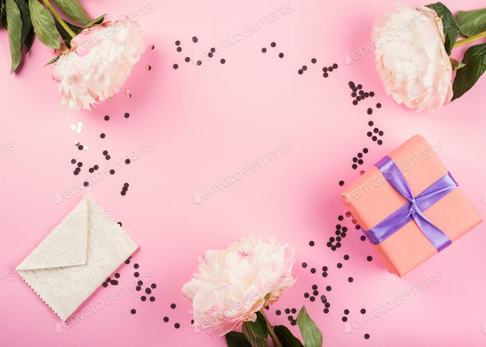 Pink pastel background with gift boxes, peonies