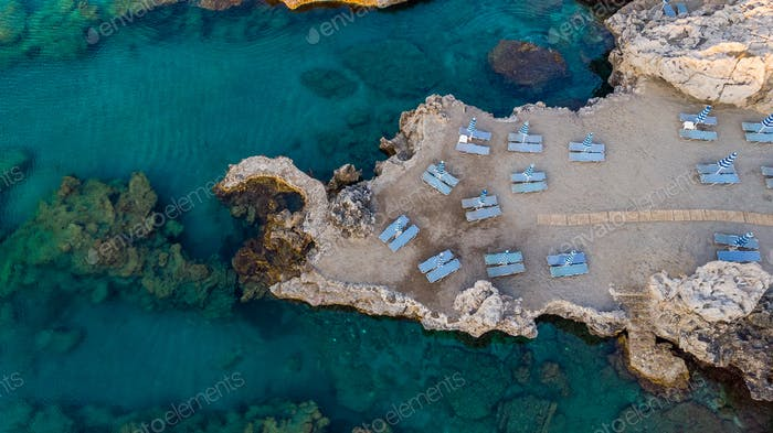 Sun Umbrella and Chairs on Beach At Mediterranean Sea, Drone Top