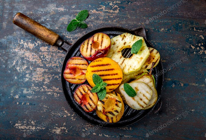 Grill Fruits - Pineapple, Peaches, Plums, Avocado, Pear on Black Cast Iron Grill Pan