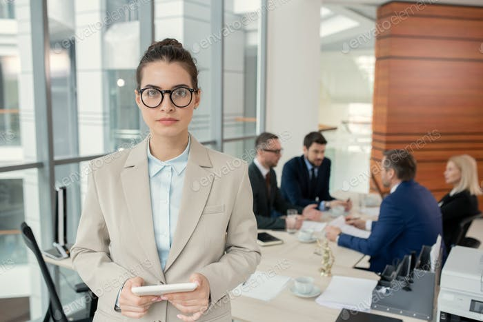 Businesswoman standing at office during meeting
