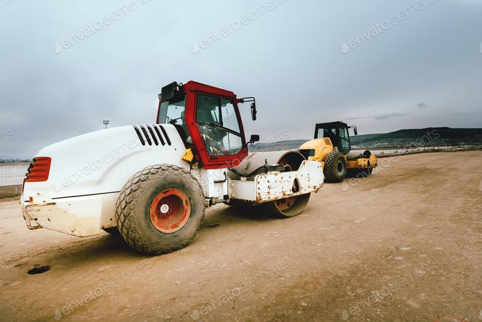 Heavy duty industrial tandem road roller on road construction site