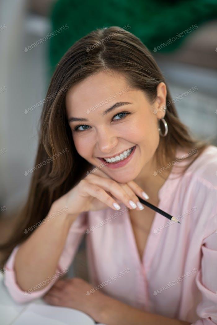 Portrait of a joyful nice business woman