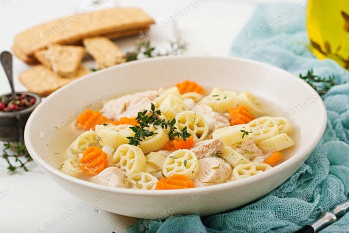 Dietary soup with turkey or chicken fillet with pasta Ruote and herbs