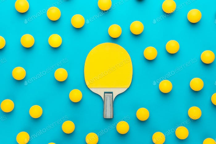 flat lay image of table tennis paddle and many balls central composition