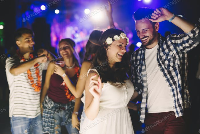 Friends dancing at festival outdoors