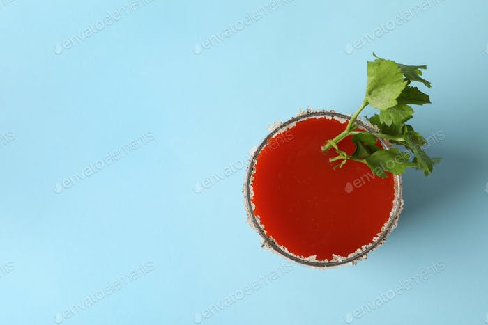 Glass of Bloody Mary on blue background