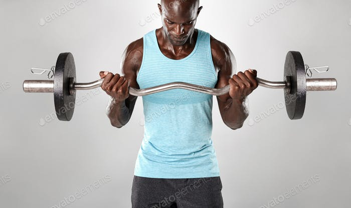 Muscular man exercising with weights
