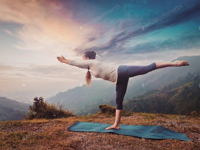 Woman doing Ashtanga Vinyasa Yoga asana Virabhadrasana 3 Warrior