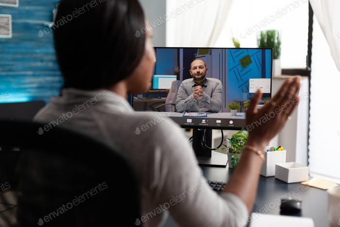African american woman using university elearning platform discussing with remote colleague