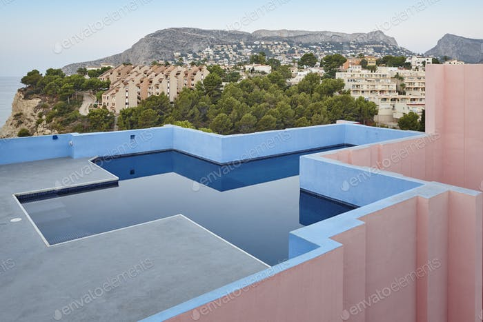 Geometric building swimming pool. Red wall, La manzanera. Calpe, Spain