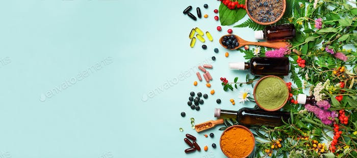 Holistic medicine approach. Healthy food eating, dietary supplements, healing herbs and flowers