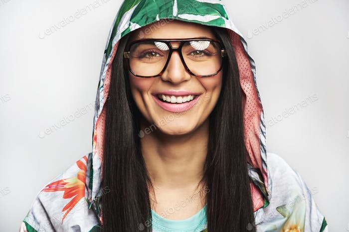 Attractive friendly young Indian woman in glasses