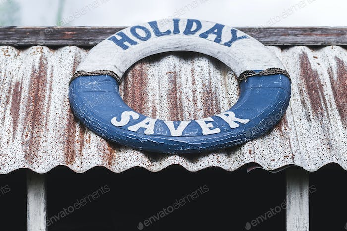 """Wooden lifeline as a decoration with the sign """"Holiday Saver"""""""