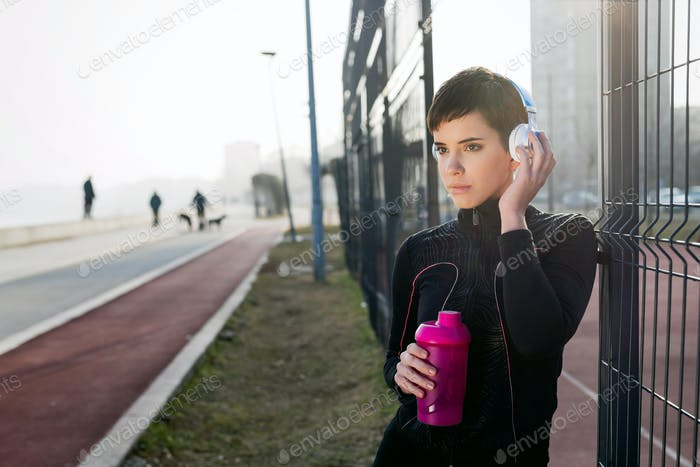 Attractive sportswoman exercising fitness and jogging outdoor