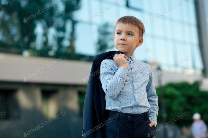 School boy posing in formal wear, elegant clothes