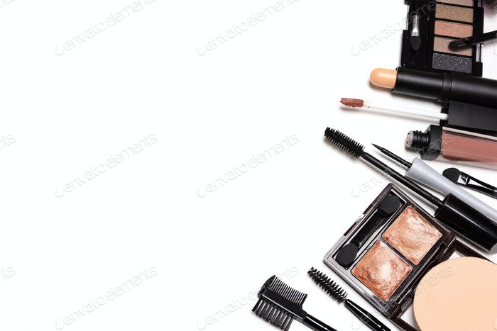 Day natural makeup essentials on white background with copy spac
