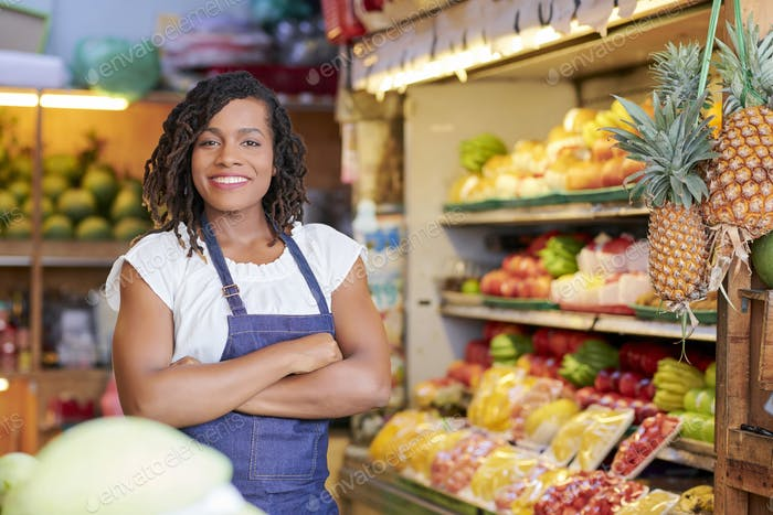 Pretty grocery store saleswoman