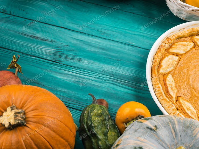 Thanksgiving flat lay with pumpkin pie