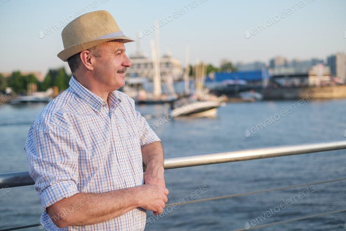 Hispanic man standing on seaside on a sunny day