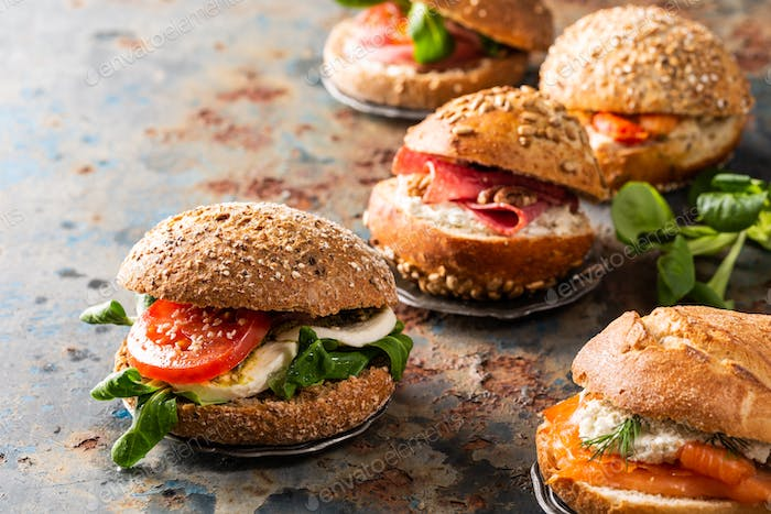 Italian Caprese sandwiches with fresh tomatoes, mozzarella cheese