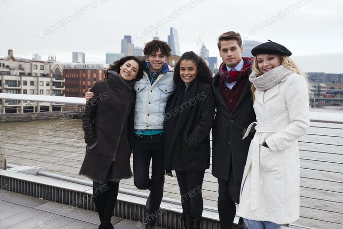 Portrait Of Young Friends Visiting London In Winter