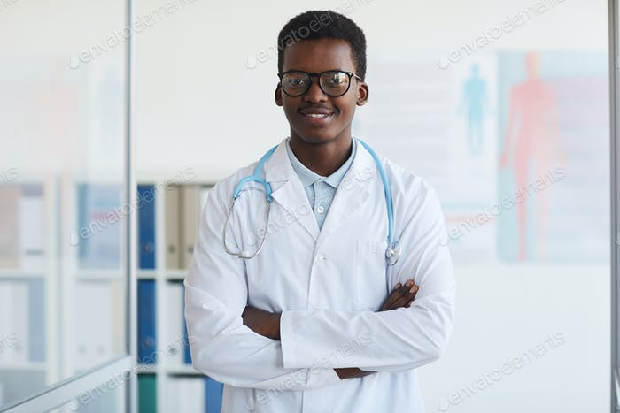 Young African Doctor Posing in Clinic