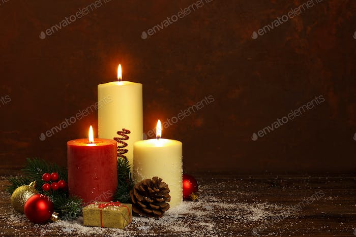 candle with christmas decorations