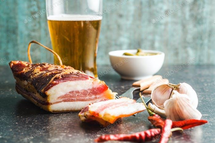 Sliced smoked bacon.