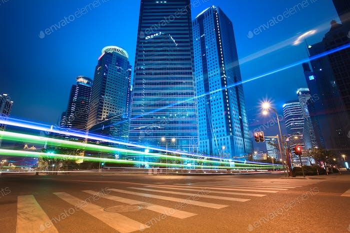 urban roads car light trails of modern buildings