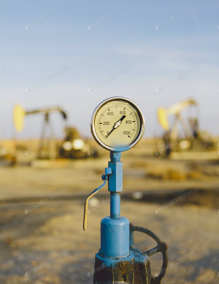 Air pressure gauge, oil rigs in background, Sunset-Midway oil fields, the largest in California.