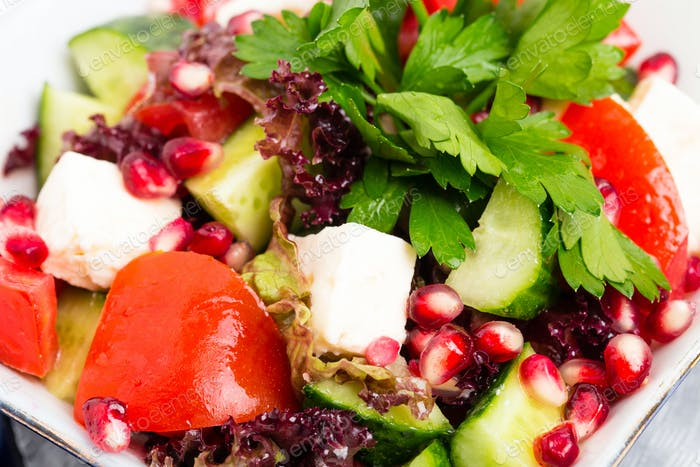 Tomato salad with feta cheese and pomegranate.