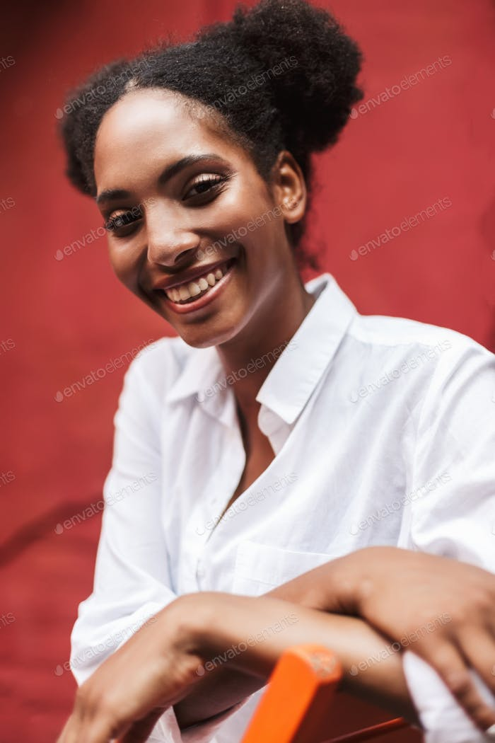 Portrait of beautiful smiling african girl with dark curly hair
