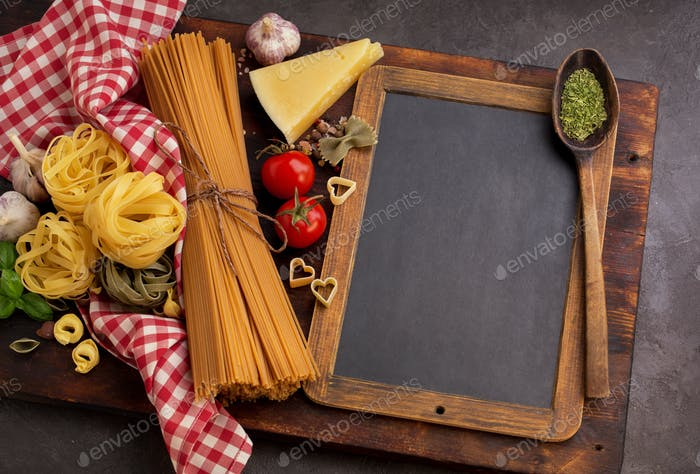 Different pasta and blackboard