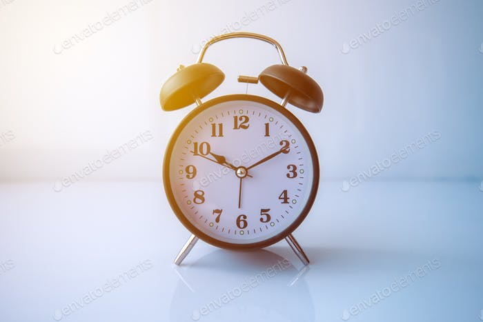 Retro style analog black alarm clock