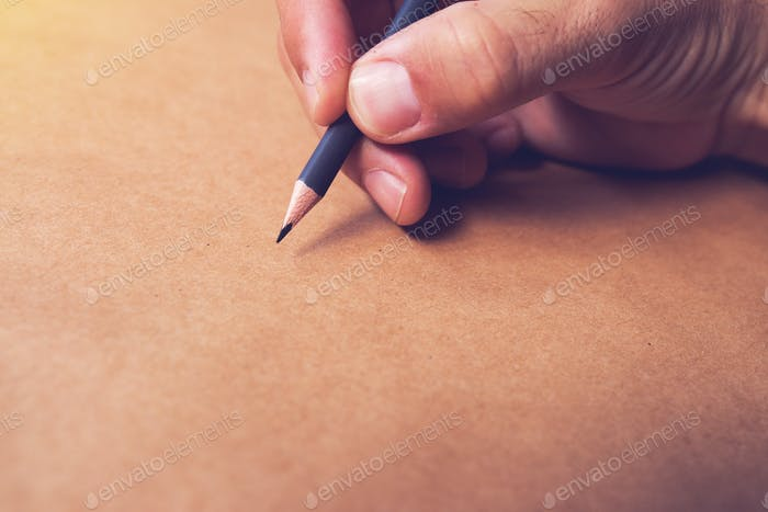 Male illustrator and sketch artist drawing with pencil