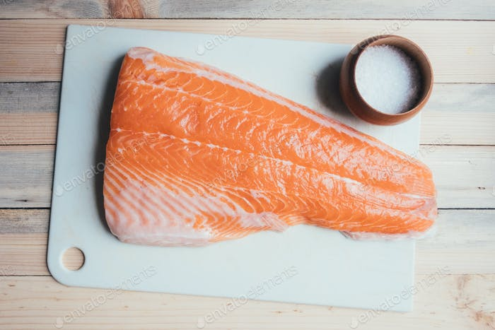 Fillet of salmon fish on white paper closeup