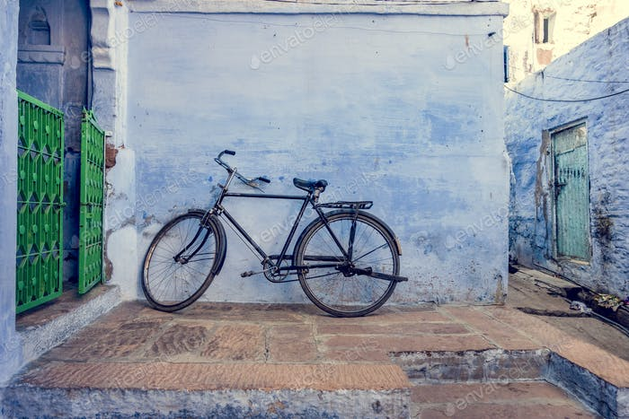 Bicycle leaning on the blue wall