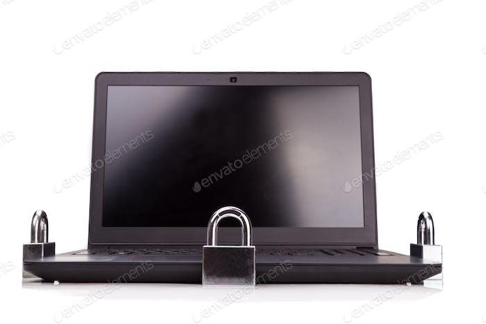 Concept of computer security with padlock as shield over laptop
