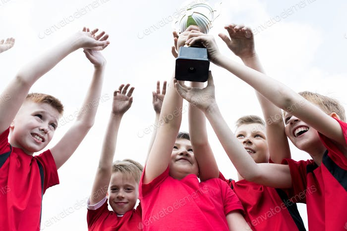 Junior Team Holding Trophy
