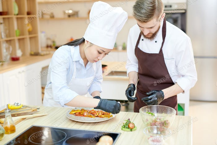 Chefs Working on Dishes